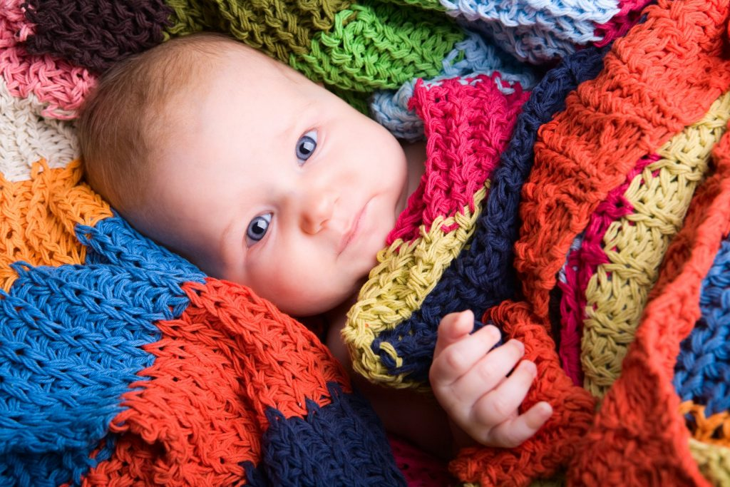 Baby in colourful blanket – Birth, Baby & You – Dee Bell – Lactation Consultant for Kent, Surrey & Sussex