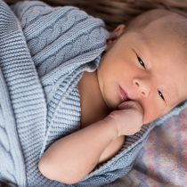 Sleepy baby in blue blanket – Birth, Baby & You – Dee Bell – Lactation Consultant for Kent, Surrey & Sussex