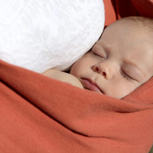 Sleeping baby in orange sling – Birth, Baby & You – Dee Bell – Lactation Consultant for Kent, Surrey & Sussex