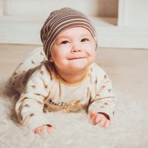 Baby crawling on fur rug – Birth, Baby & You – Dee Bell – Lactation Consultant for Kent, Surrey & Sussex